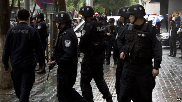 China -Xinjiang: Police Shoot dead 13 Police Station 'Attackers'