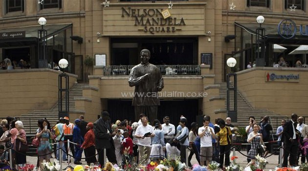 Woman strips Completely Naked to hug Mandela statue in South Africa