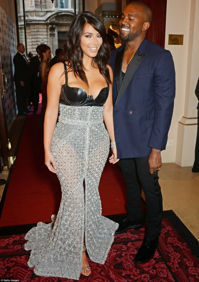 Kim Kardashian and Hubby Kanye West loved up at GQ Awards. See Kim's revealing gown