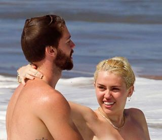 Miley Cyrus Frees Her Nipples While on Vacation in Hawaii with Boyfriend Patrick Schwarzenegger (NSFW Photo)