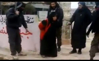 Shocking moment Muslim woman is publicly executed by al-Qaeda supporters for 'adultery'