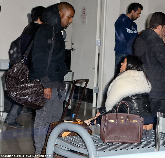 Kim Kardashian Flashes Butt Crack at Airport in Wardrobe Malfunction