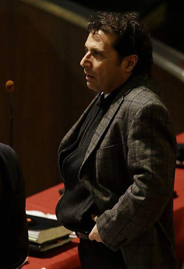 Francesco Schettino attends his trial at the Grosseto court, Italy, Wednesday, Feb. 11, 2015. Whatever verdict is delivered in the trial of the Italian sea captain for the shipwreck of the Costa Concordia cruise liner and for the deaths of 32 people, survivors and victims' families already are wondering if justice will be done. The trial, expected to bring a verdict this week, has a sole defendant. Francesco Schettino is accused of causing the shipwreck on the night of Jan. 13, 2012, when he steered too close to a tiny Tuscan island, smashing into a granite reef that sliced open the hull, sending seawater rushing in. (AP Photo/Gregorio Borgia)